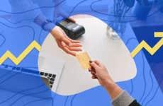 Person handing a merchant a credit card
