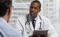 Doctor discusses treatment with patient