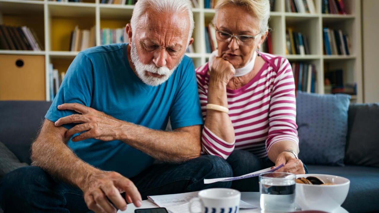 Senior couple managing finances