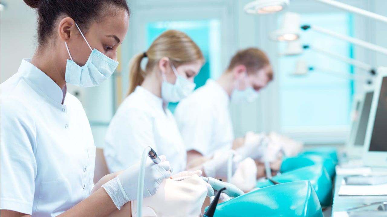 Dental school students train on mannequins