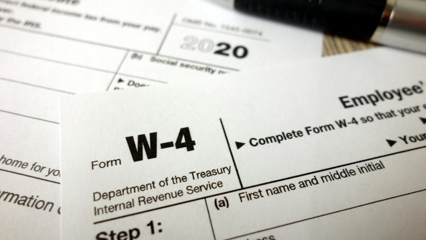 Blank W-4 form and a pen