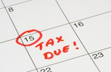 15th day on calendar circled and marked with TAX DUE
