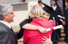 Parents embrace graduating college student