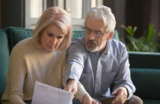 Husband and wife look over financial documents