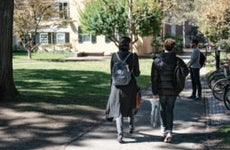 Students walk on Harvard campus