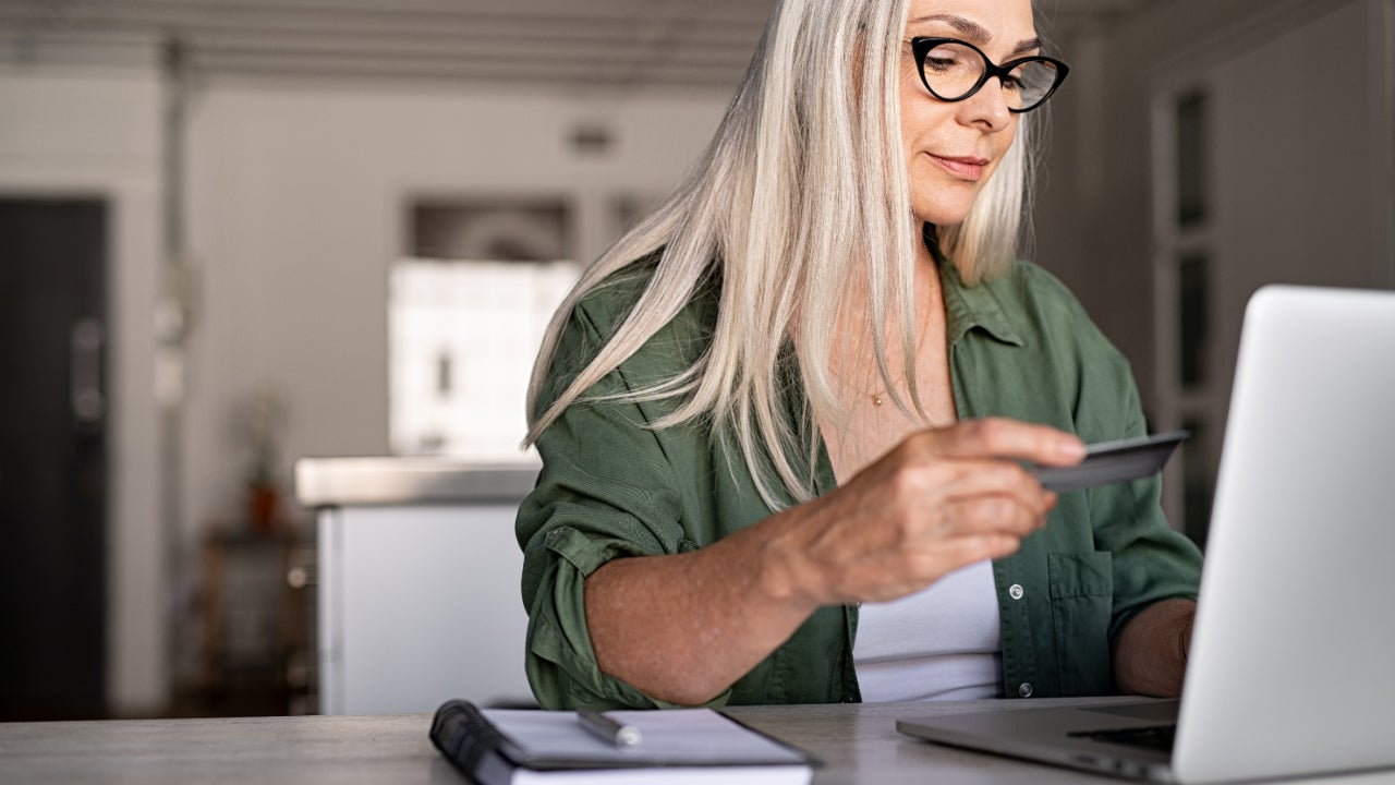Person looking at credit card