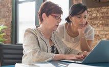 Businesswomen using laptop