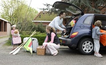 A family loading up a car for a big trip.