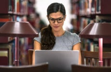 Law school student works in library