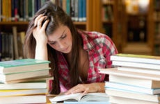 College student studies in library