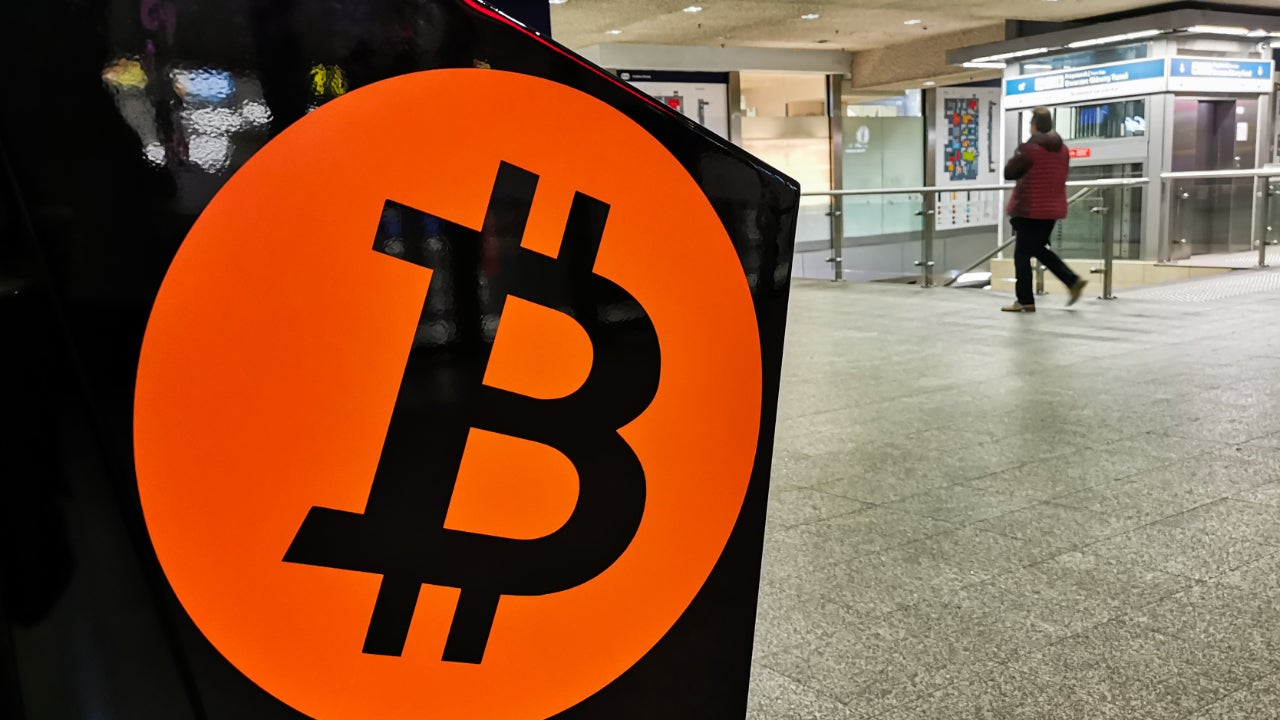 A photo of a bitcoin ATM in a train station