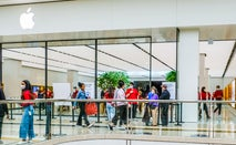 An Apple store in Chadstone Shopping Centre with Apple staff wearing red T-shirts and face masks as a precaution against the spread of covid-19.