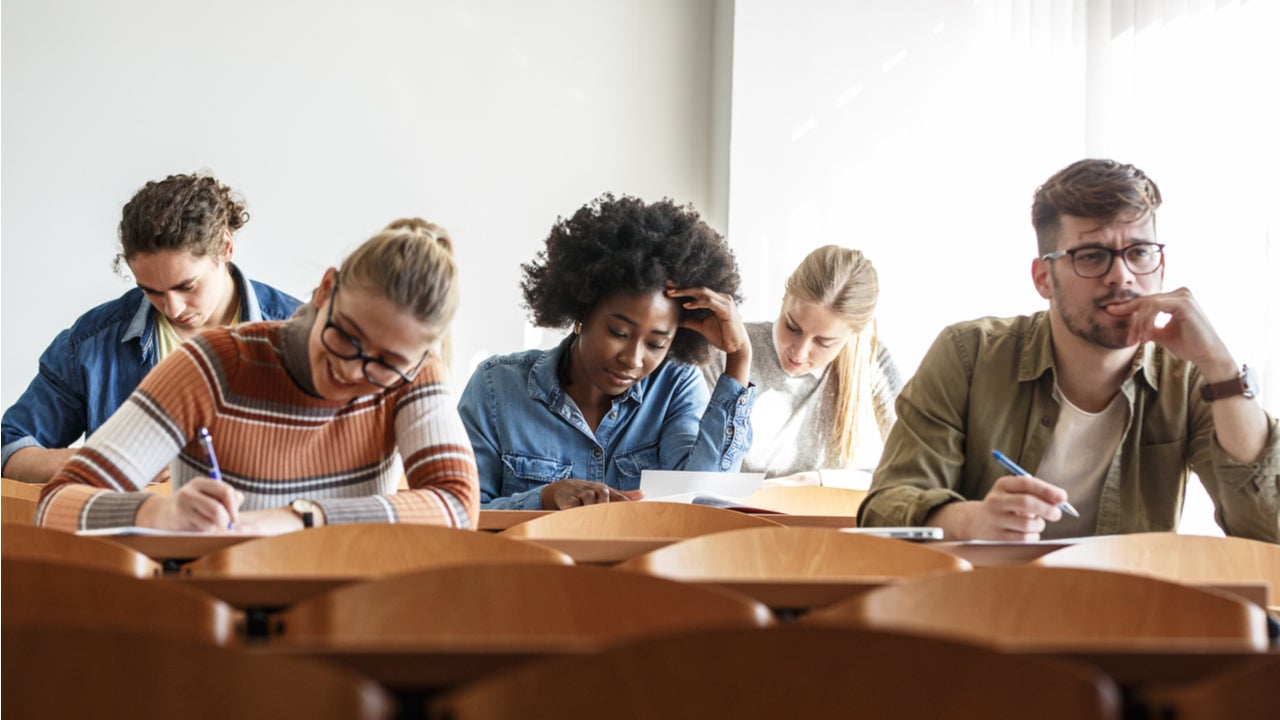 Students take notes in a college classroom