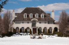 A mansion in the snow.