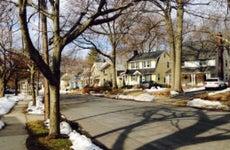 A suburban neighborhood with piles of old snow