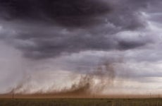 A windstorm sweeping dust up from the ground in rural Texas.