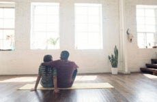 Young couple sitting on a rug in a loft