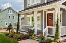 A two-story single-family home with front porch