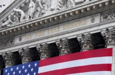 A picture of the New York Stock Exchange with an American flag draped on it