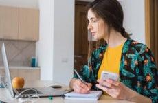 Woman paying bills online