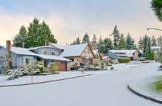 Nice neighborhood in cold, chilly and frosty winter time covered with snow.