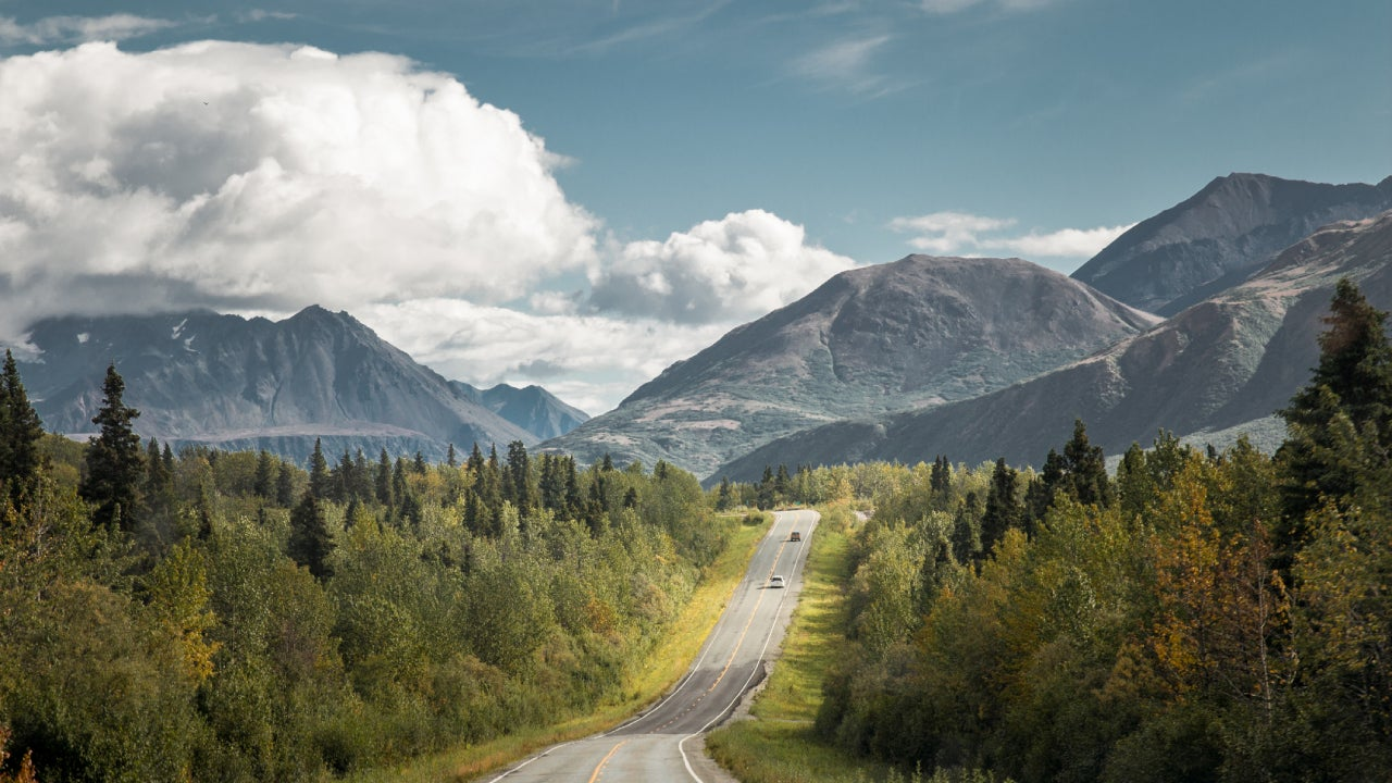 Rural Alaska road leading into the mountains