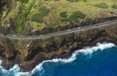 Winding coastal road on Hawaii coastline.