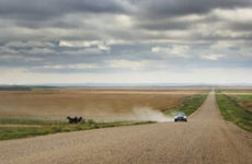 Rural dirt road out in South Dakota wilderness.