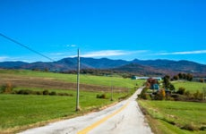 Long stretch of road in the Vermont countryside.