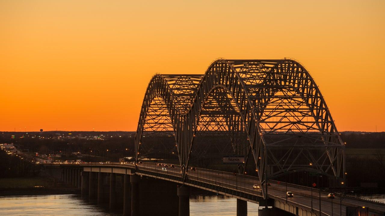 The famous, iconic bridge leading into Memphis at twilight.