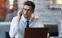 Businessman on phone with credit card company