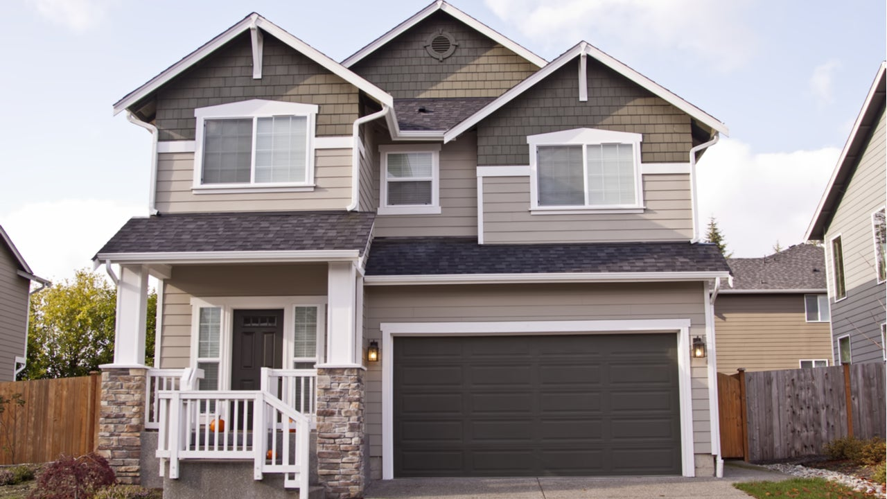A single-family, two-story home with attached garage