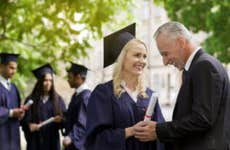 Dad attends daughter's college graduation