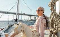 A woman relaxes on a boat.