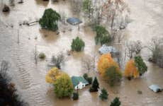 An Aerial View of Houses Surrounded by Flood Water