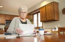 Old woman looking at her finances