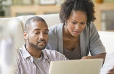 Black couple looking at finances