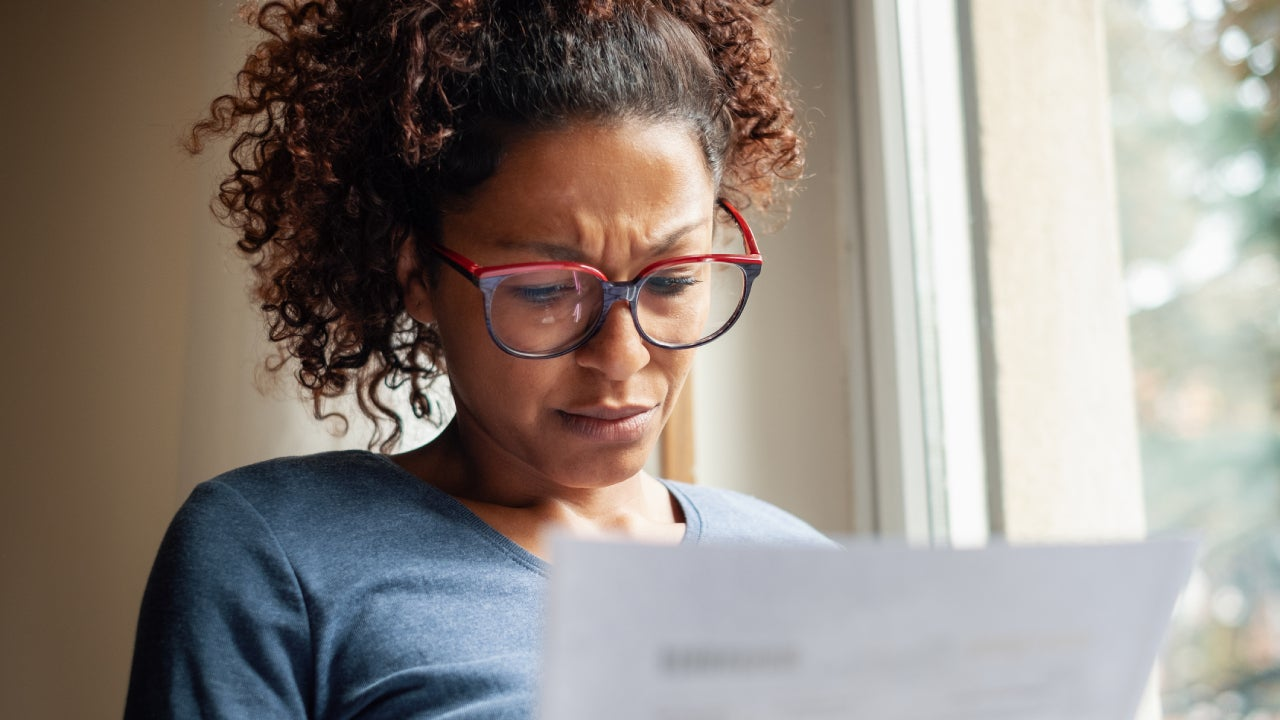Concerned black woman looking at her finances