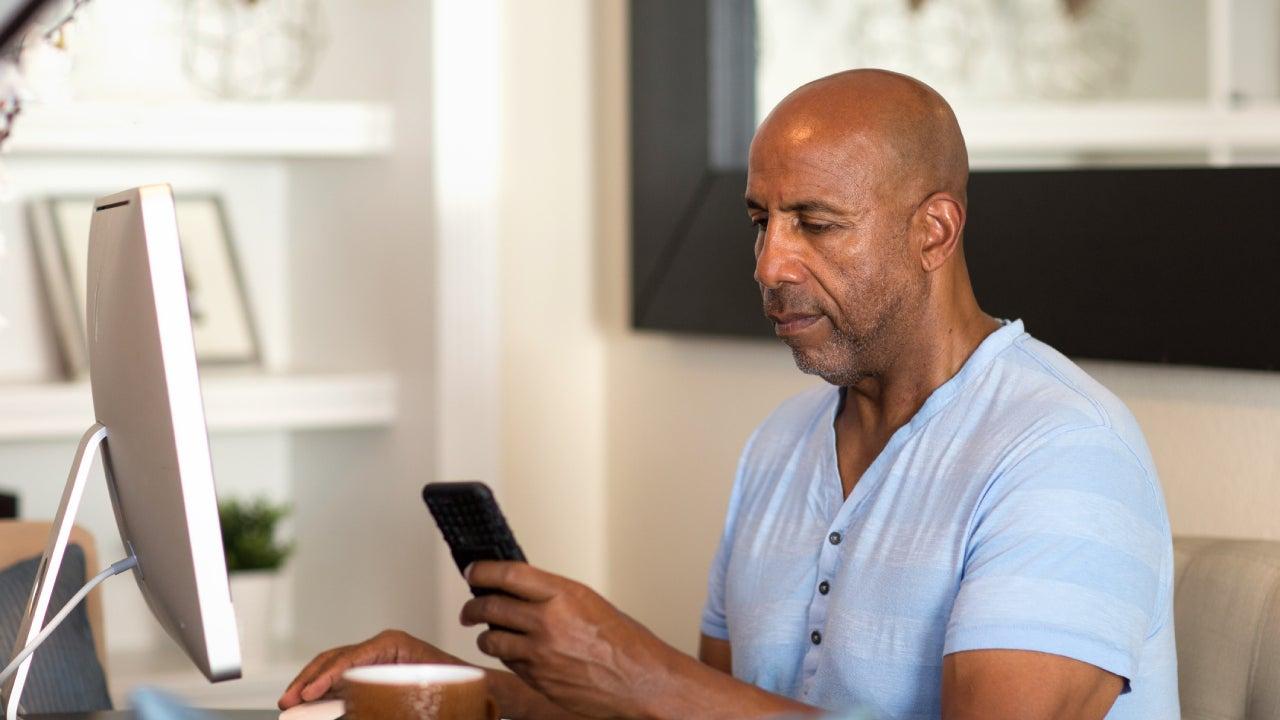 Concerned black man looking at finances