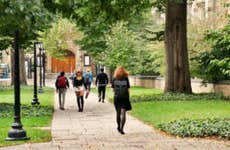 Students walk on a college campus