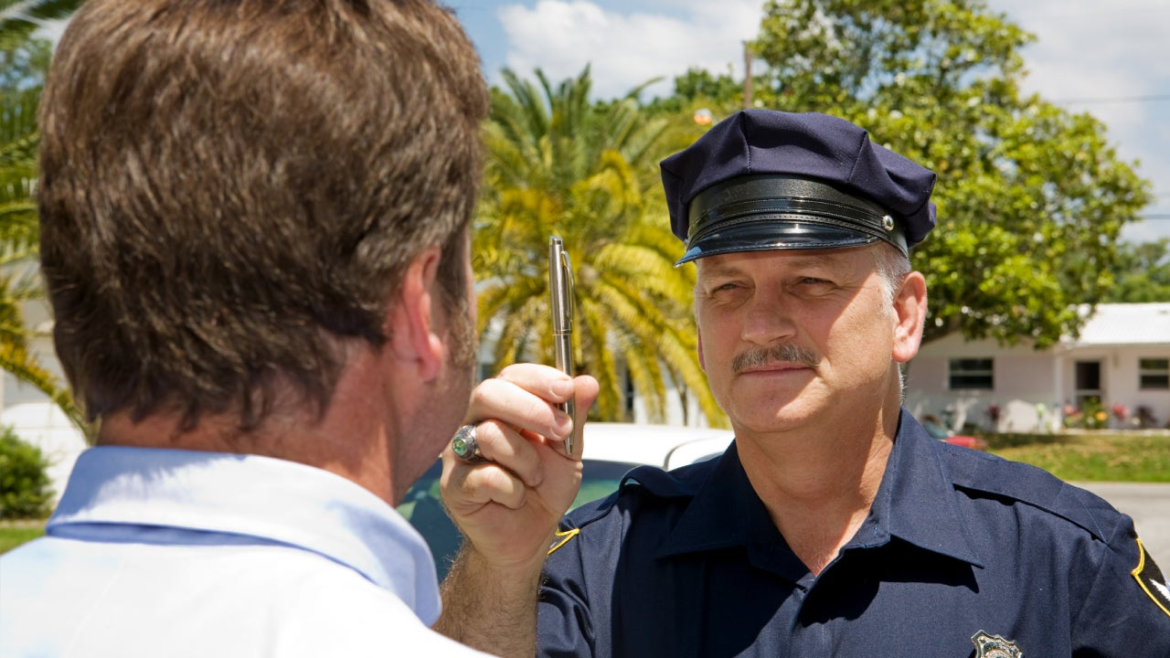 Cop performing an eye coordination test