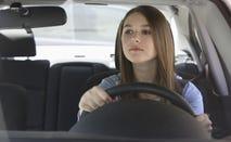Caucasian teenage girl driving car