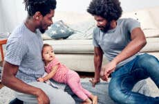 Fathers playing with daughter