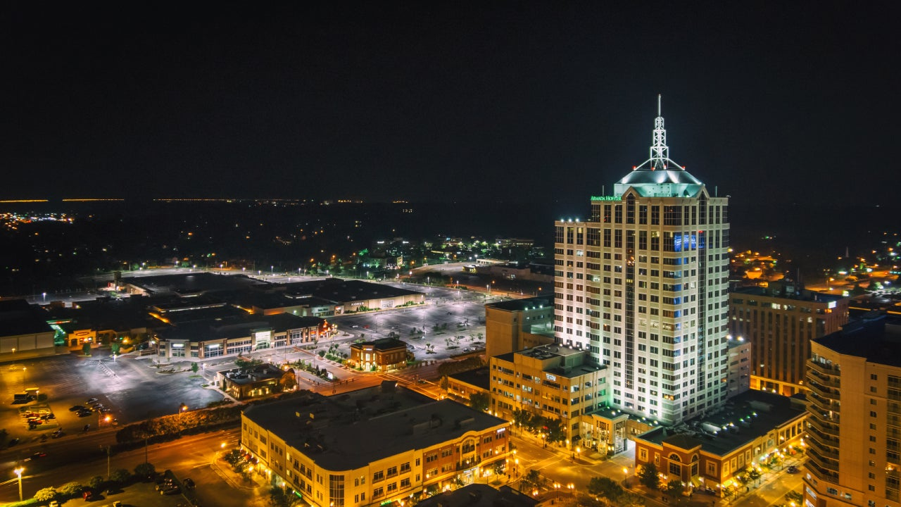 High Angle View Of Illuminated Town Center Against Clear Sky At Night