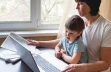 Parent working from home with child on lap