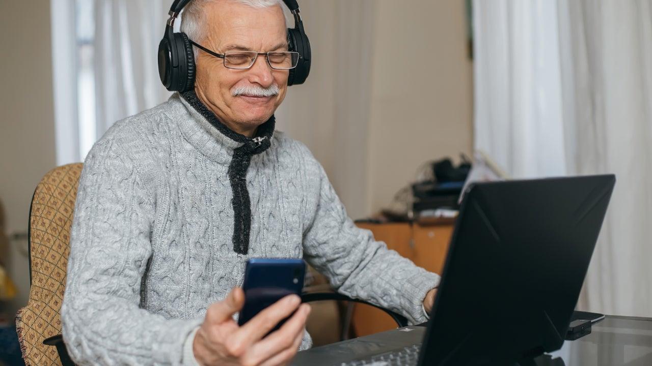 A senior man researches online.