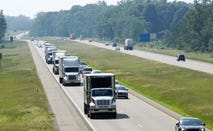 View of the highway traffic with trucks lined up