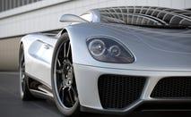 A silver sports car on black tile floor