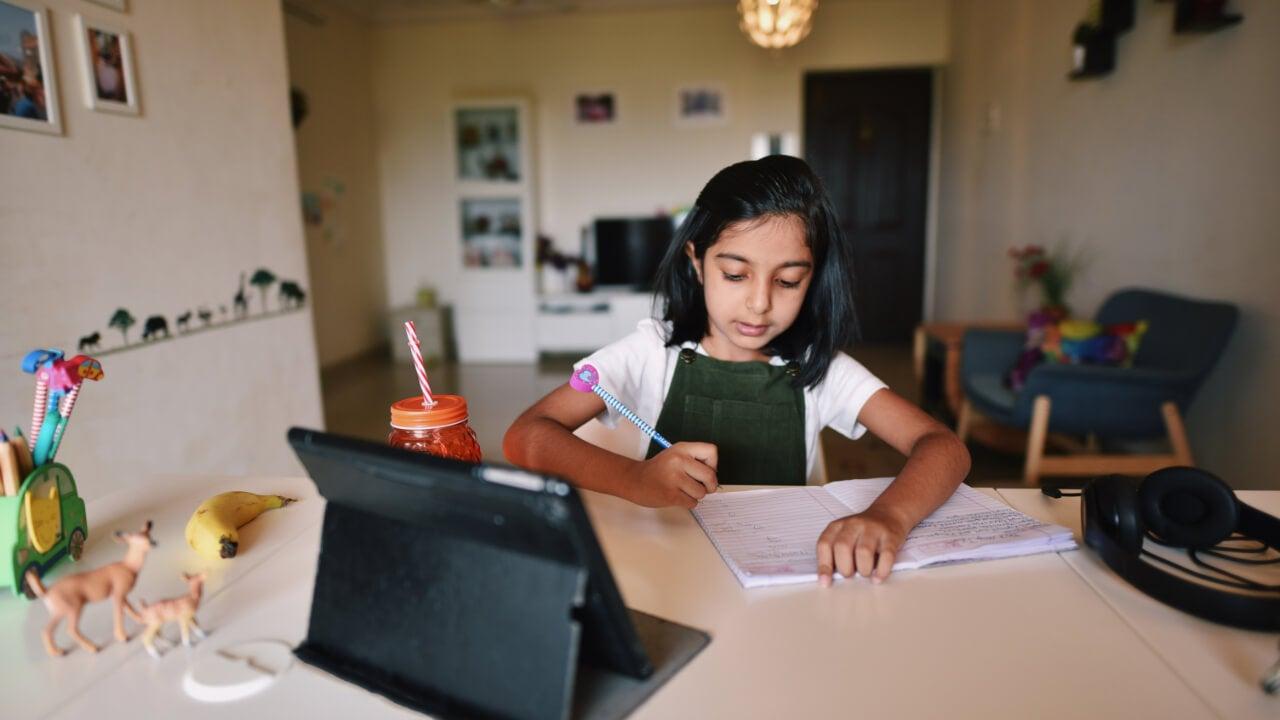 Young girl attending virtual school
