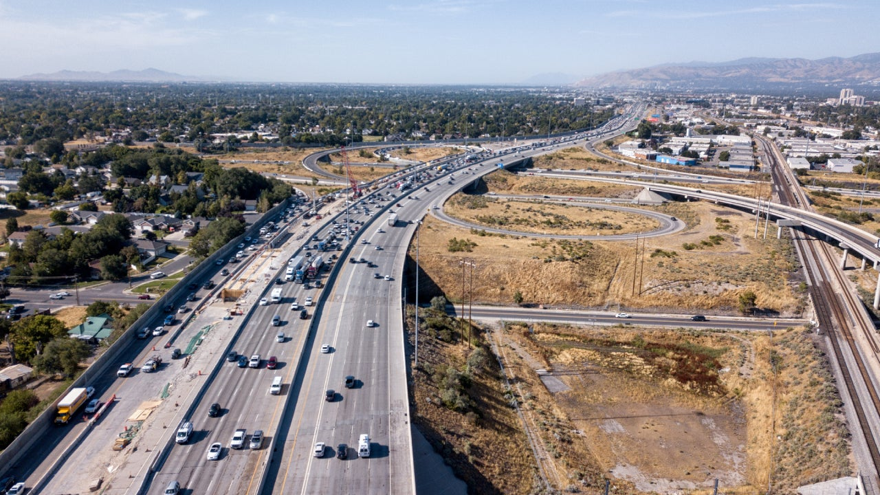 Aerial Drone Clip Looking Down On I-15, I-80 Of The Commuter Traffic And Road Construction Around Salt Lake City